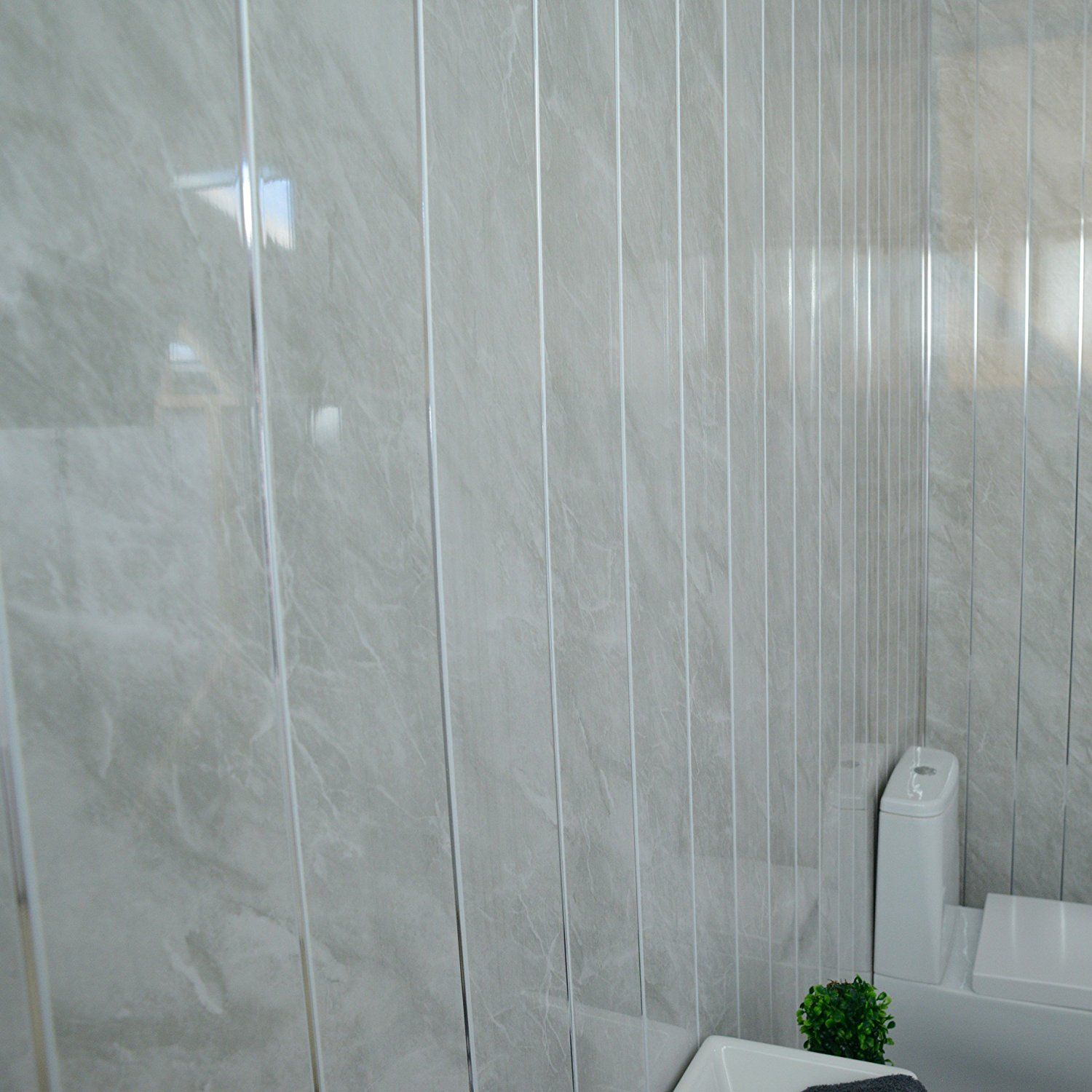 Grey marble bathroom wall panels with chrome silver strips, Cladding ...