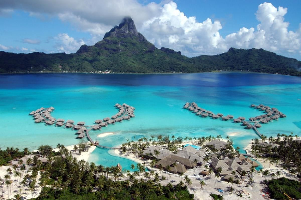 Bora BoraThe idyllic island of Bora Bora, also part of French Polynesia, is surrounded by a crystal blue lagoon and barrier reef.