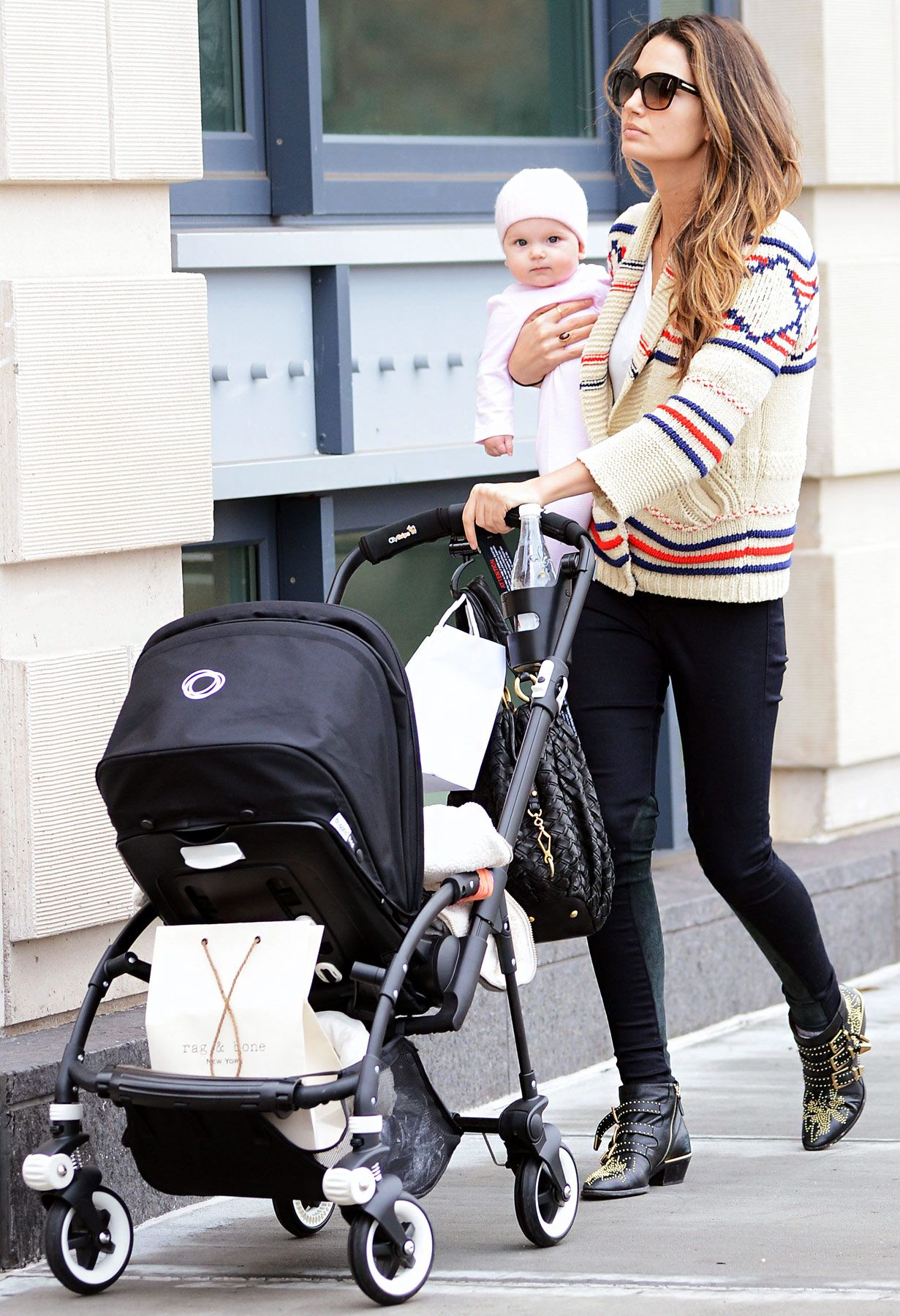 Carry baby cause she s tired of the stroller