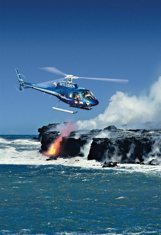 Blue Hawaiian Helicopter Flying Over Molten Lava Flowing