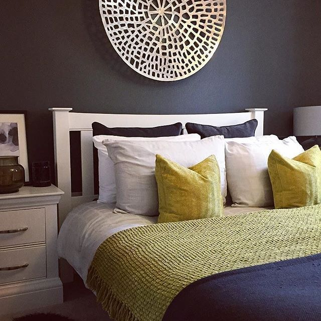 Wonderful Pair A Dark Colour Wall With Bright Coloured Bedding To Make Your Bedroom  Feel Warm And