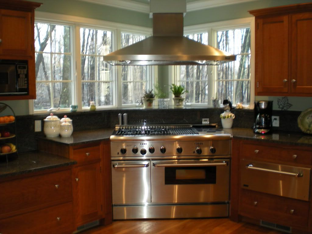 corner range with a chimney hood - windows | home: kitchen