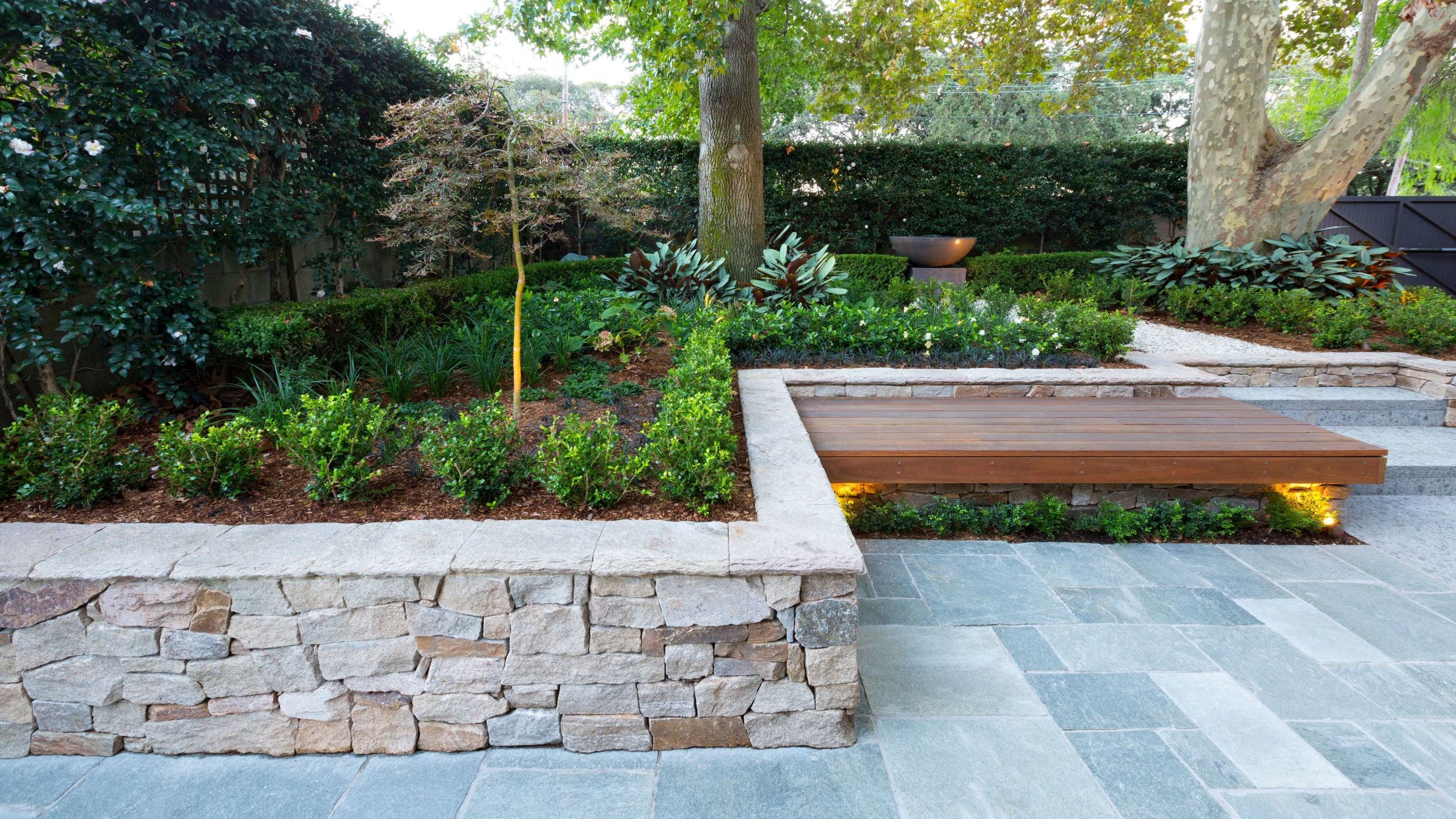 An organic dry stone feature wall in a classic garden design ...