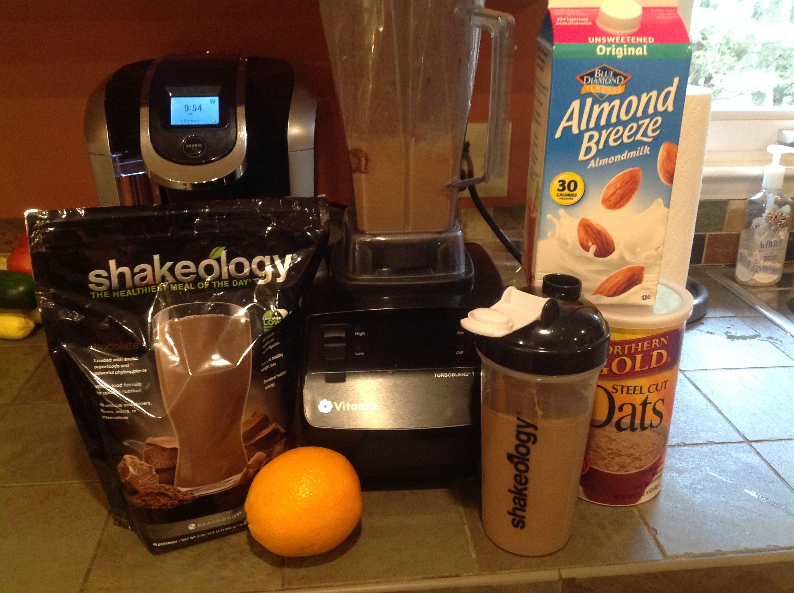 Chocolate Shakeology, Unsweetened Almond Milk, 1 tblsn raw steel cut oats, 1/2 frozen Orange