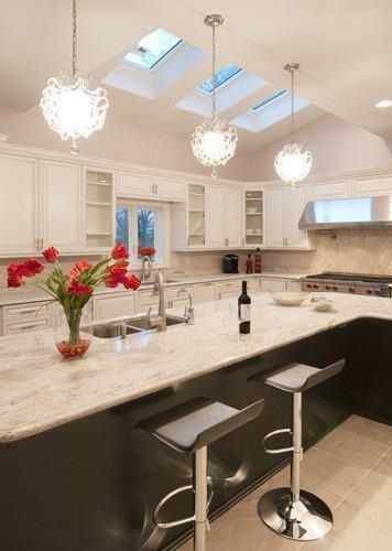 Fun use of skylights and light fixtures in this kitchen.