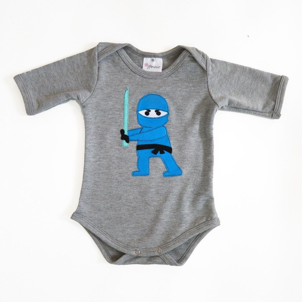 Introducing the  Glammic™ onesie! Currently available in Size 9-month with 3/4 length sleeves.  Look for more onesies from us in the future!  In grey, with a hand cut & sewn Ninja applique. $35