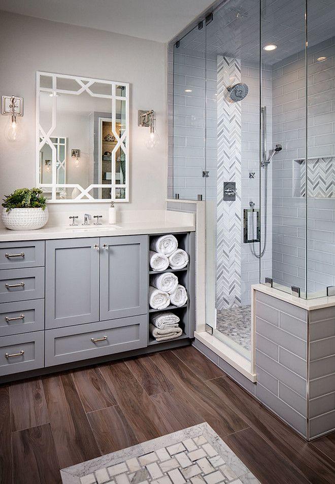 Grey bathroom tiling. Grey tiles. Heringbone accent tile is Arizona Tile Grey Polished Mesh. Grey subway tile is a 4x16 Arizona Tile H-Line. Grey bathroom tiling ideas. Grey bathroom tiling. #Greytiling #bathroomtiling grey-bathroom-tiling Tracy Lynn Studio