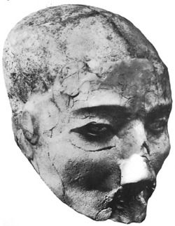 Plastered skull, from Jericho, Israel, about 7000-6000 BCE.    Jericho, one of the first large human settlements, cherished and preserved their dead within the foundations of their homes. After death, family would bury the body, revisit it, and eventually remove the skull (sans lower jaw) and model clay and plaster to mimic fleshed appearance of their ancestor. Often, cowrie shells were used to imitate eyes, and bitumen was used to accentuate the eye sockets.