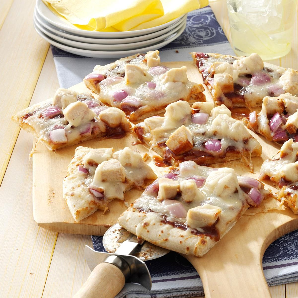 Barbecued Chicken Pizza Recipe -This pizza starts with a prepared bread shell and barbecue sauce, plus leftover cooked chicken. I simply assemble and bake. Often, I cut the pizza into small bite-size pieces and serve it as an appetizer at parties or potluck dinners.—Patricia Richardson, Verona, Ontario