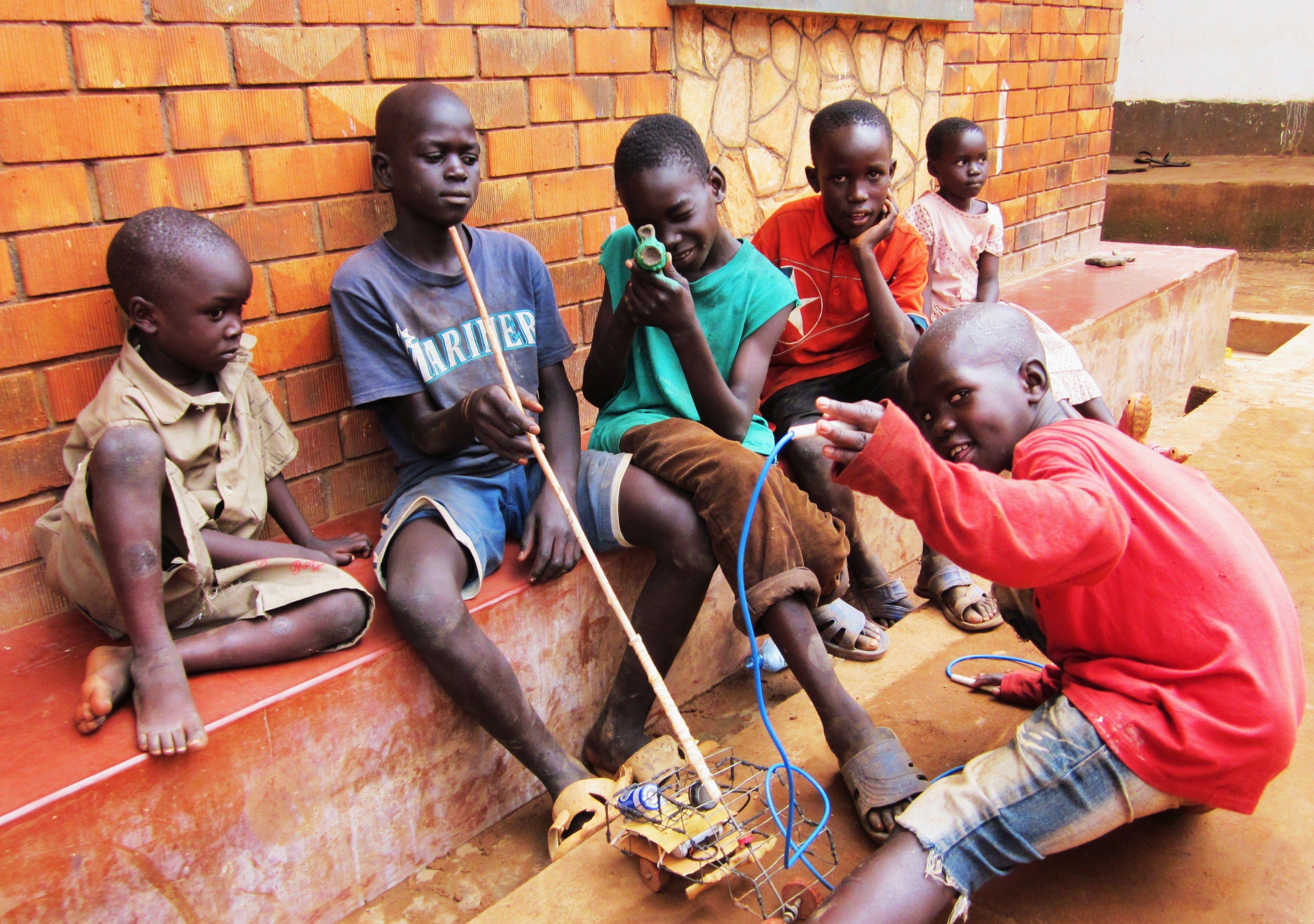 Boys And Their Toys : Boys and their toys african boy pinterest