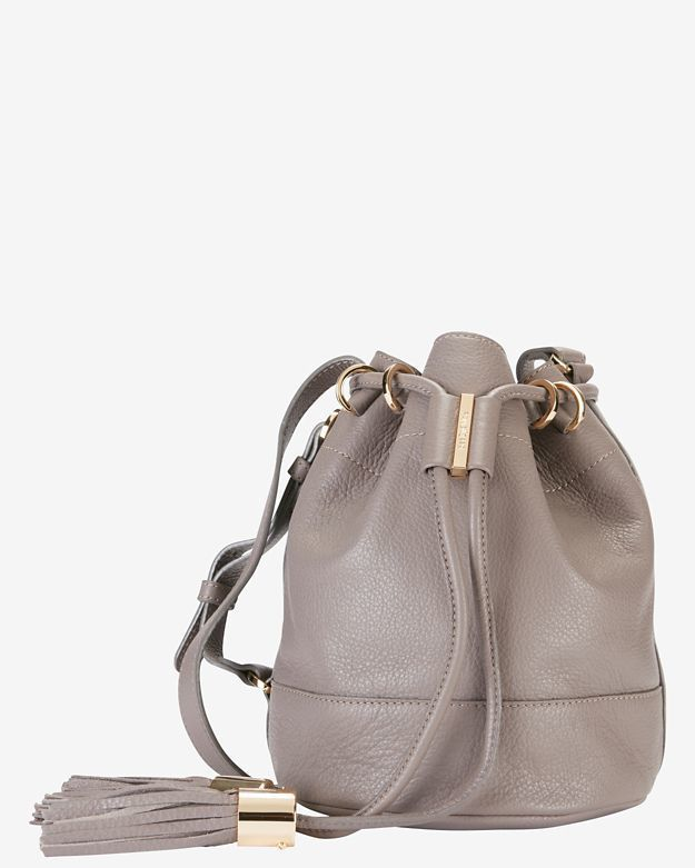 7b42209226a45 The See by Chloe tassel leather bucket bag in grey is one of our favorite  bags right now!