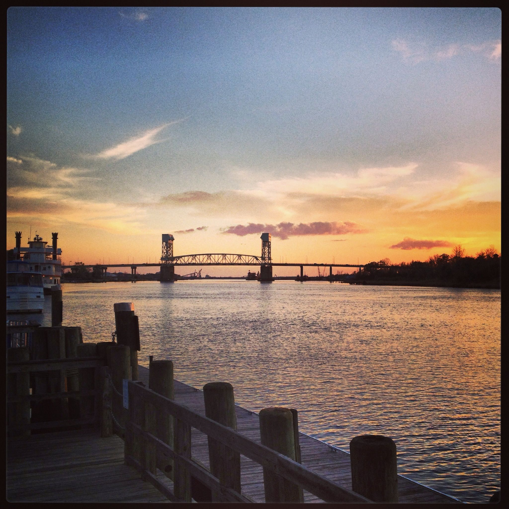 View of the Cape Fear Memorial Bridge from the downtown Riverwalk, Wilmington, NC. www.SeaCoastRealty.com #wilmingtonnc #sunset #river #capefear #bridge