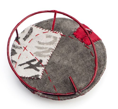 grey and red brooch
