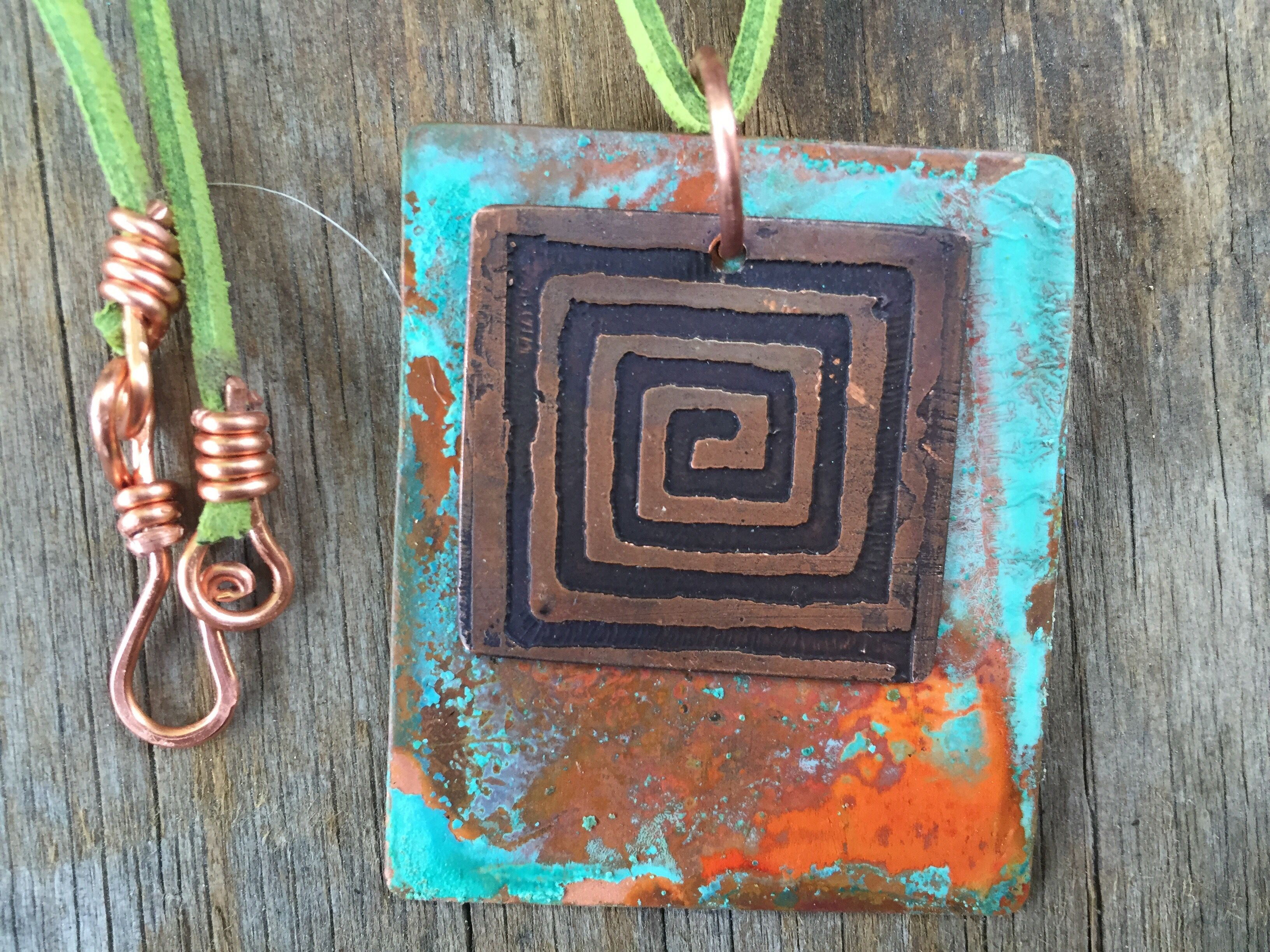 Etched and patina copper pendant. Patina is vinegar and