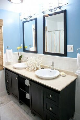 tropical full bathroom with flat panel cabinets, tiled