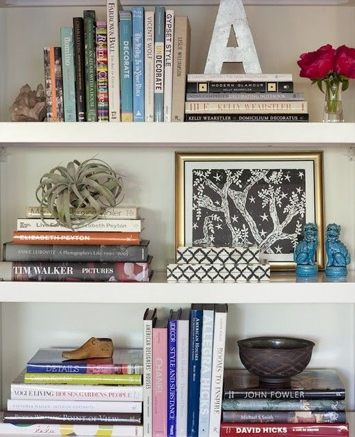 Styling of bookshelves love the mix of books art and uncommon objects