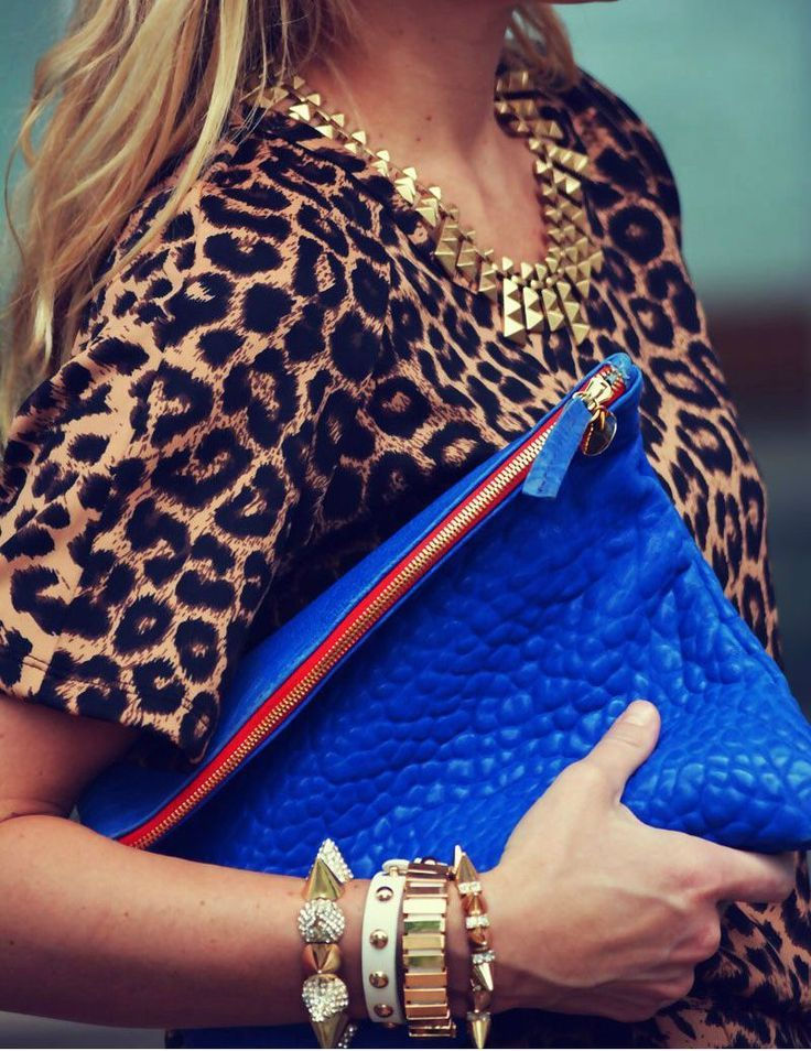 leopard, gold jewelry and blue clutch