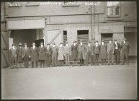 """""""Published in Sydney newspapers, by the then Commissioner of Police to demonstrate to press and public that police could operate undercover. In answer to a suggestion that so distinctive was the build of the average detective, effective undercover work was out of the question. Seen here are a mix of detectives and civilians. The figure third from the right is believed to be Sergeant Frank Fahy, aka """"The Shadow"""", the force's most effective undercover operative at the time."""""""