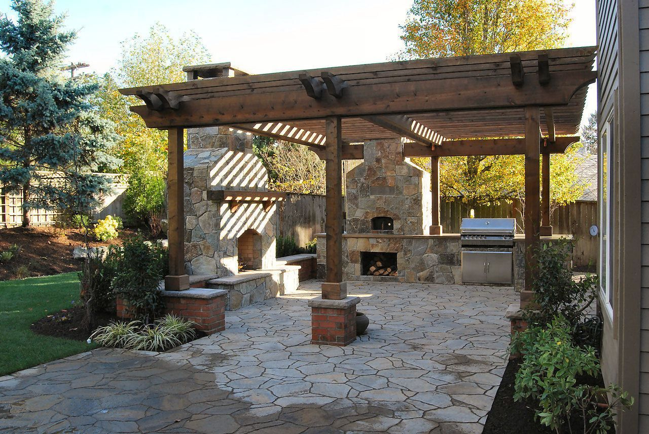 Austin stone patio Pergola on stone with fireplace pizza oven and