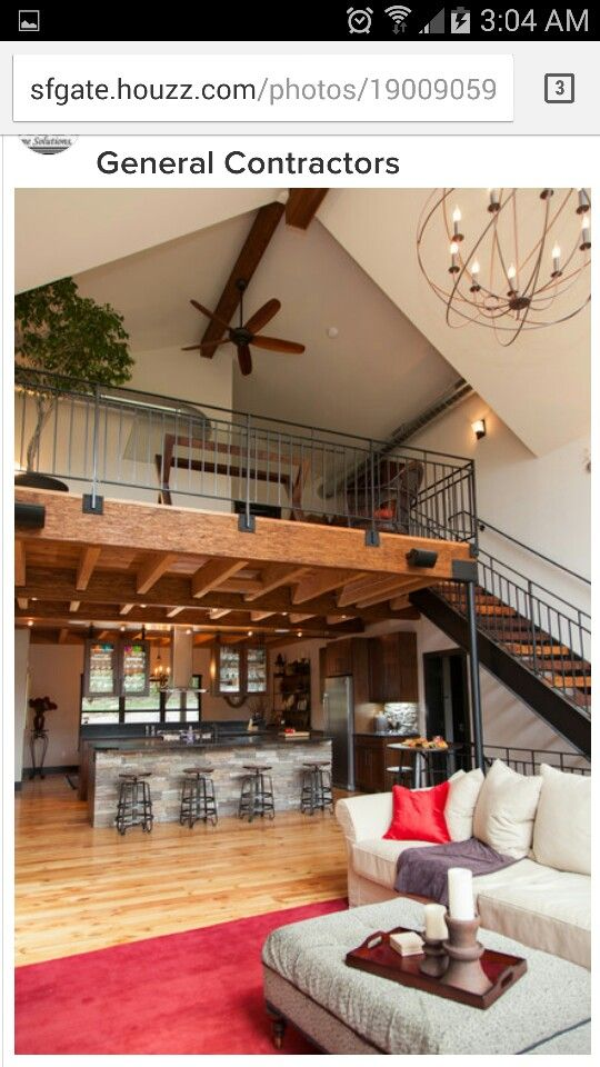 Loft over kitchen open to great room Barn house interior