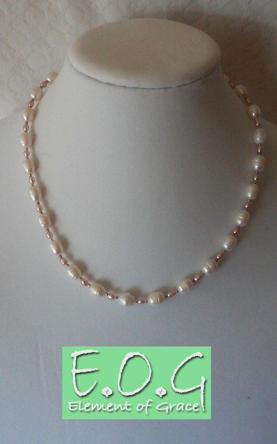 Freshwater cultured Pearls white with mauve. Simple and elegant. Grade C 3mm rice pearls on 7-8mm grade D rice pearls. I always hand pick each pearl and alternate the style in the pattern. I put the most lustrous and flawless grade in the front.