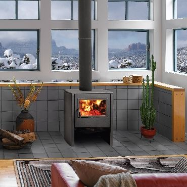 The Camano™ freestanding wood stove by Avalon features sleek ...