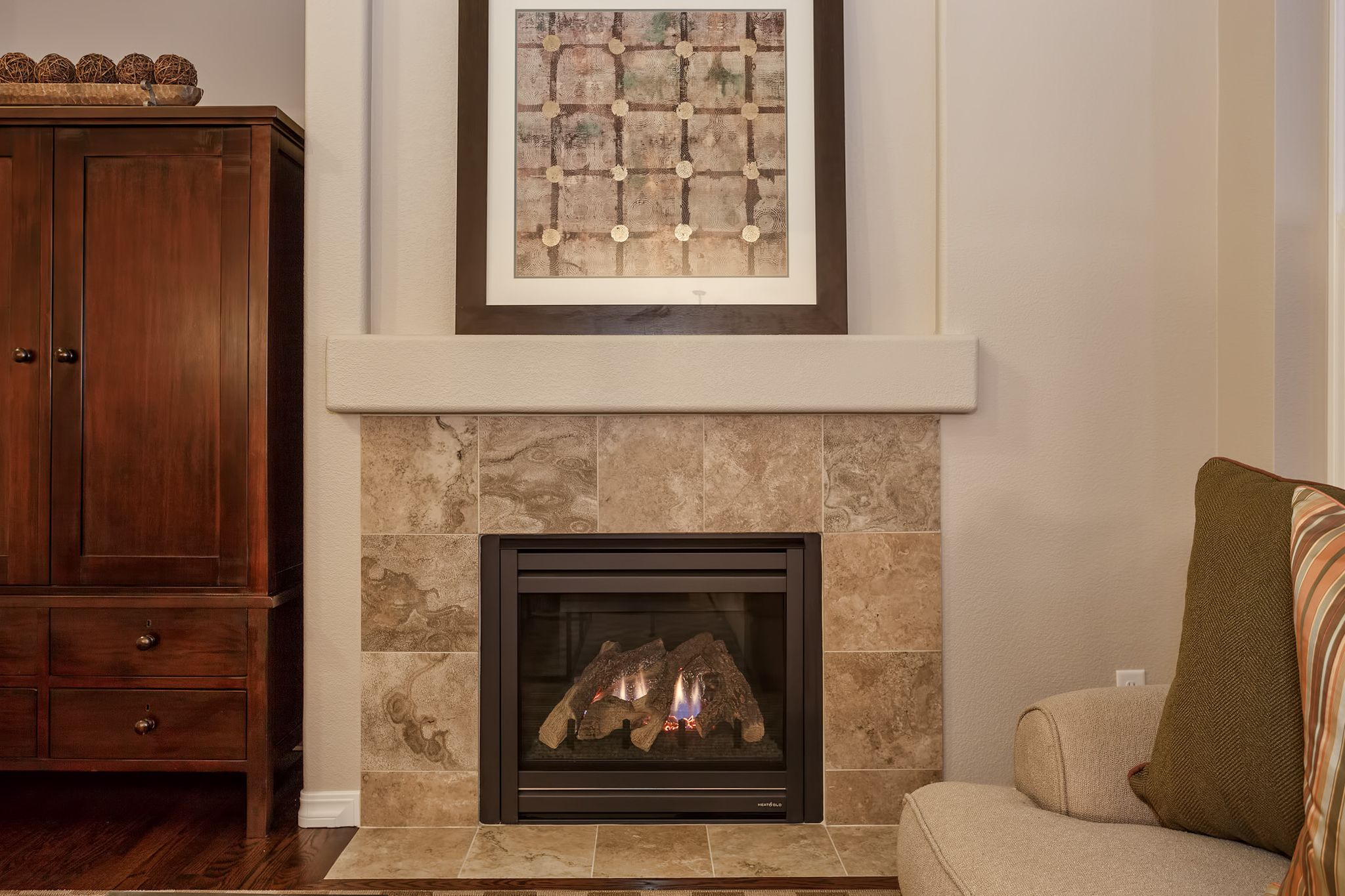 The Gas Fireplace With Custom Tile Surround Makes The Spacious