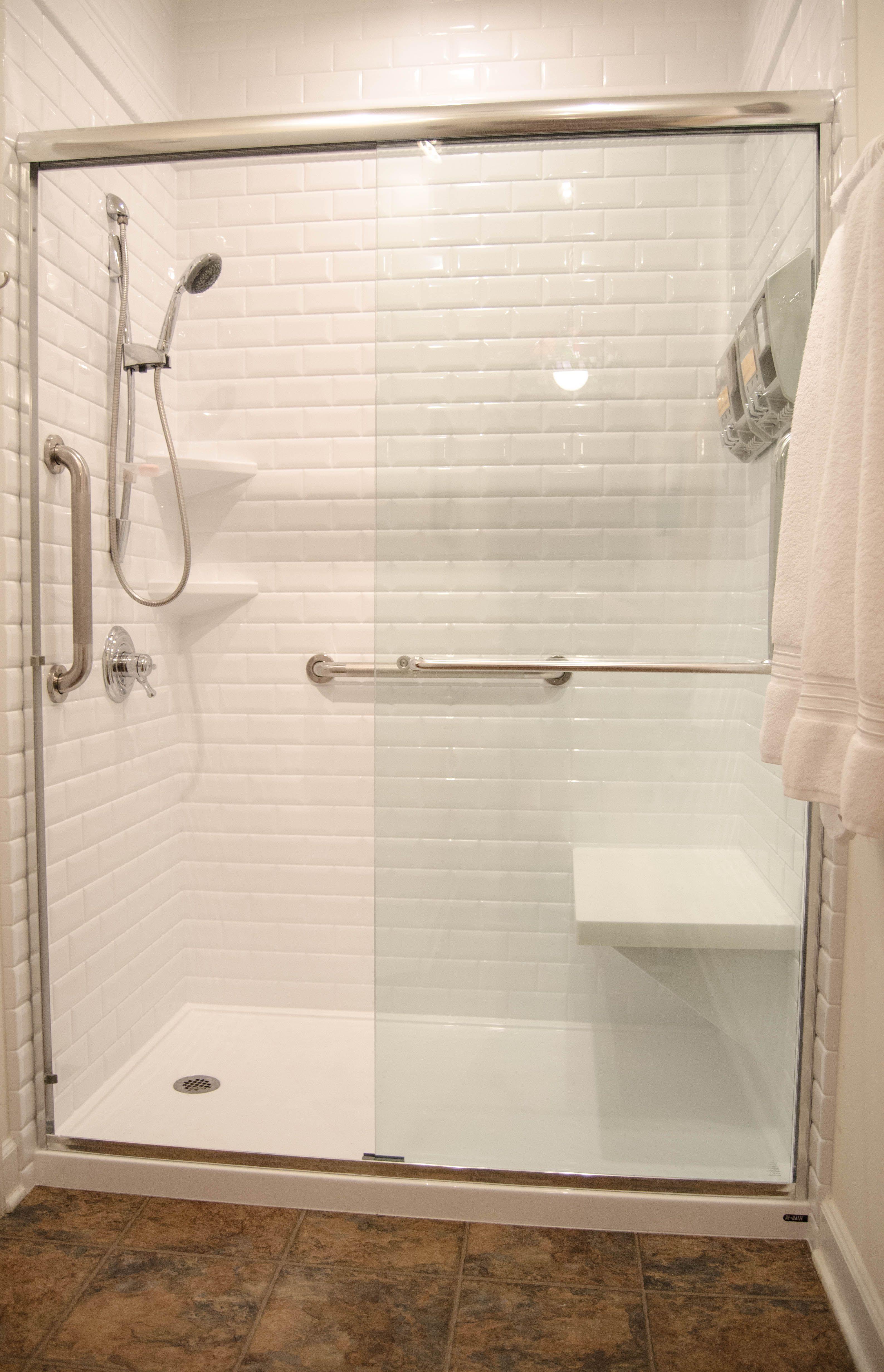 Remodeling Bathroom Doors updated bathroom remodel, shower seat, handheld shower head, grab