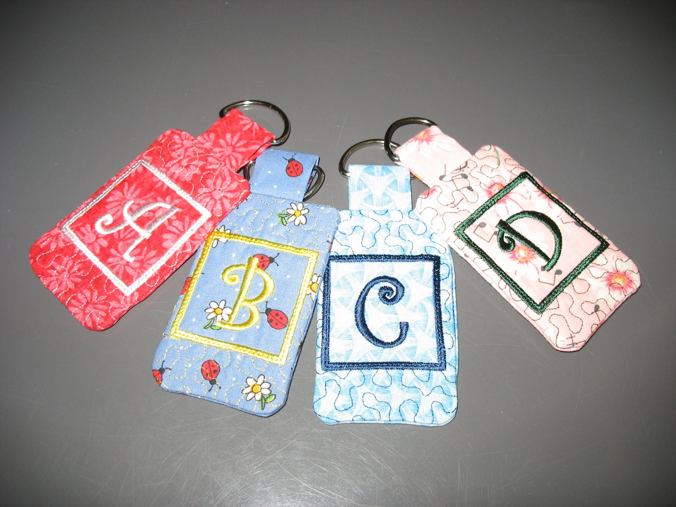 Key rings with monogrammed initials and a back pocket for your driver's license, credit card, etc.  $7.00  See my facebook page - jo's stuff