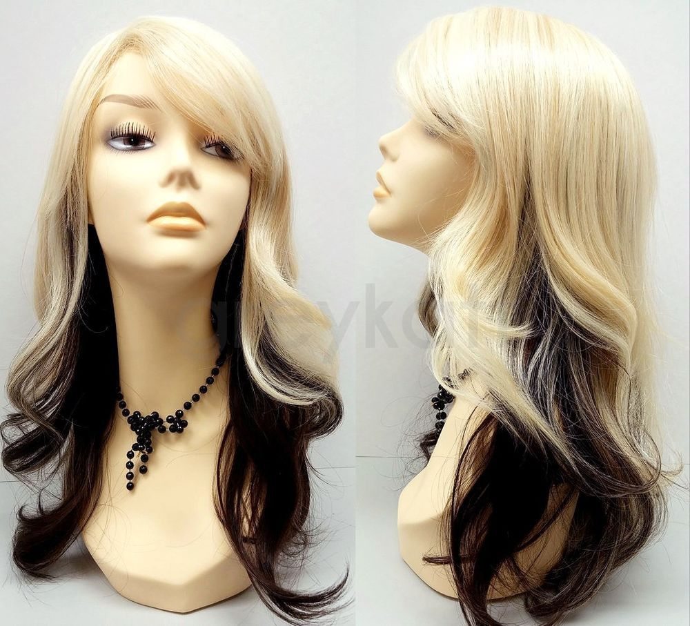 a gorgeous long blonde wig layered underneath with a dark