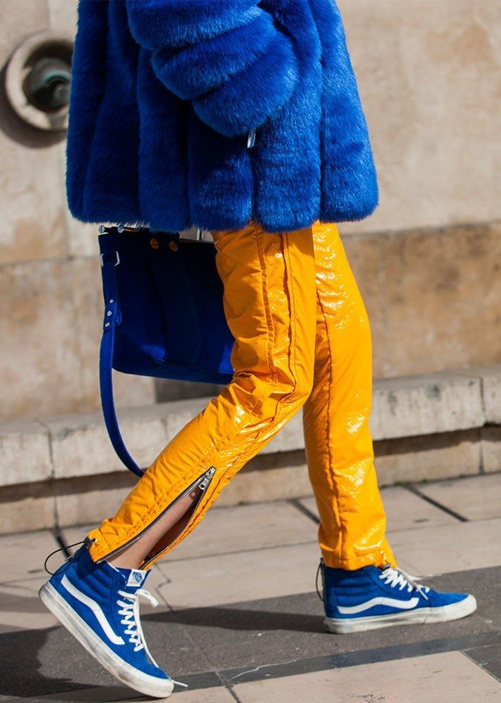 Blue vans, blue fur, and patent yellow pants.