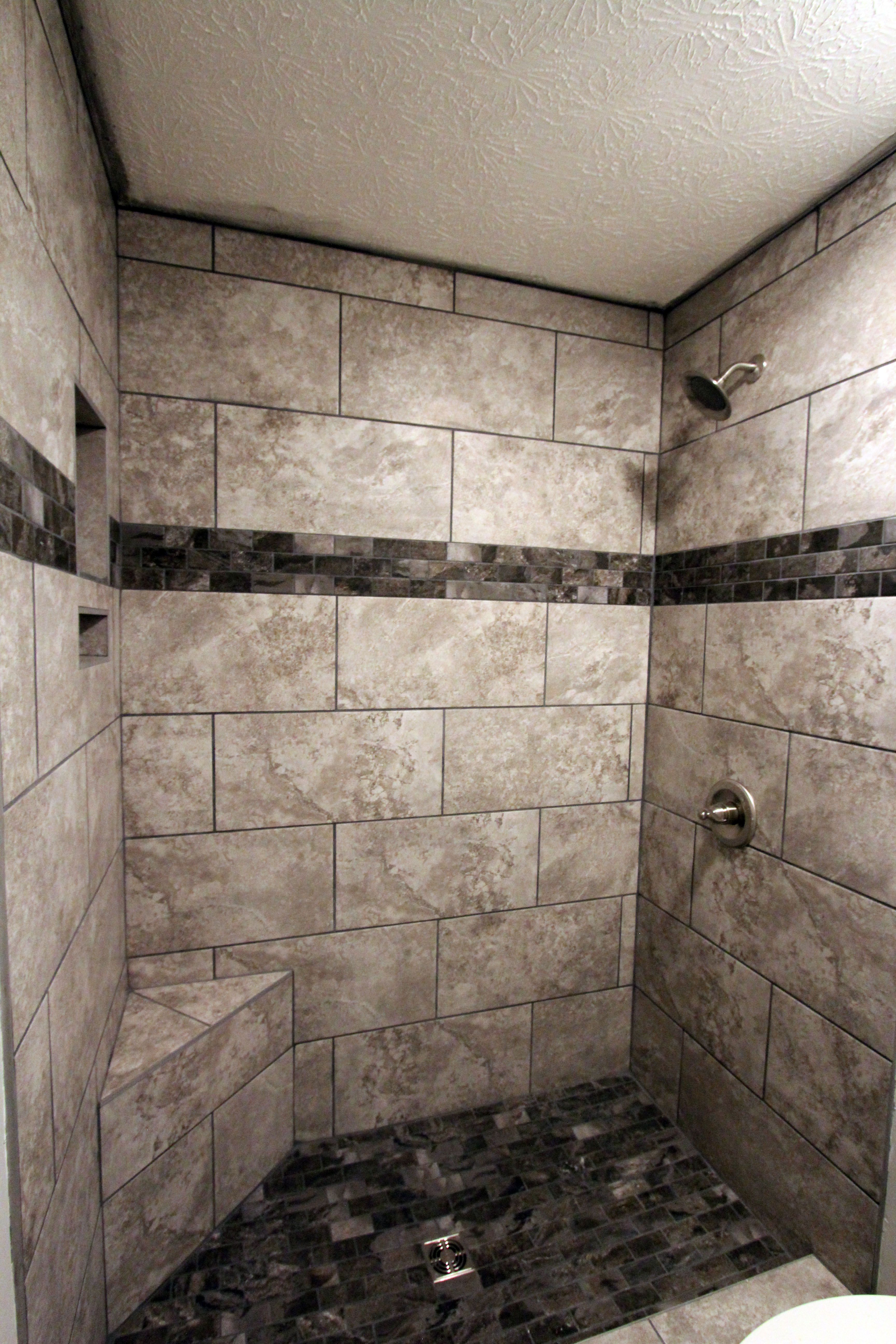 This Shower Features Our Senato Gris 12x24 Tile Accented With