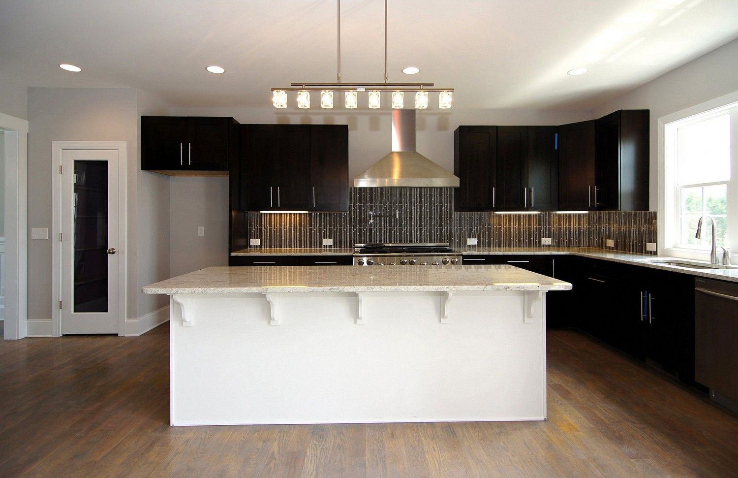 White Island With Seating Espresso Cabinets Stainless Steel Range Hood Glass Tile Back Spl Kitchen Color Trends Kitchen Cabinet Dimensions Espresso Cabinets