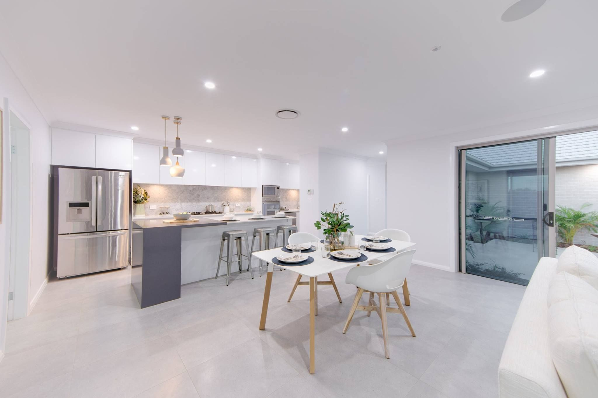 We are loving the combination of this kitchen's cool tones, pendant lighting and high ceilings. Built by the G.J. Gardner team at Tamworth.
