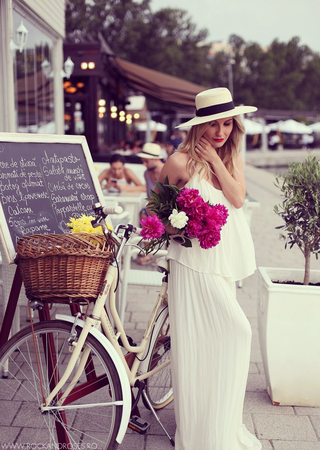 Sooo lifestyle but love it - from the hat and maxi dress to the flowers, bike w/basket and chalkboard there is a lot going on but cute. Nice haze unifies the feel of the picture.