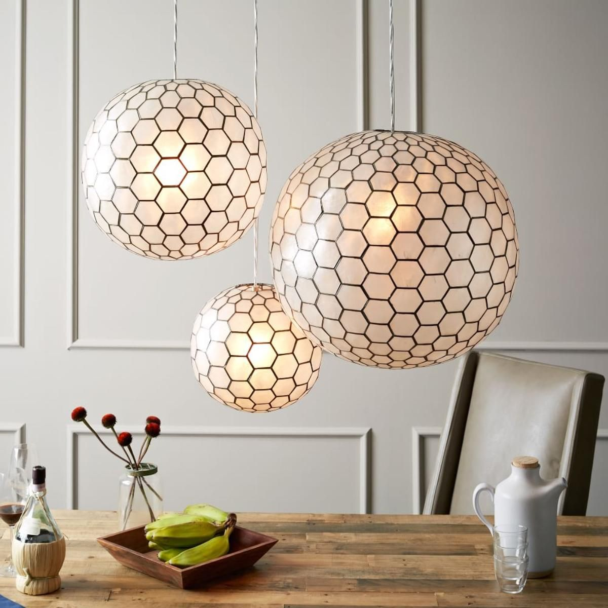 Handcrafted in the philippines the capiz shells on the capiz orb ceiling lamps are individually hand cut and set within a pewter frame the result