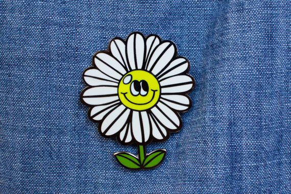 Cute Daisy Lapel Pin. This pin is made with super shiny black nickel and filled with smooth, high quality, enamel in white, bright green and yellow.