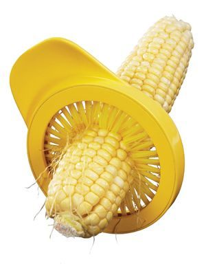 Remove any remaining silk from corn by sliding each cob through the bristles. Amco…