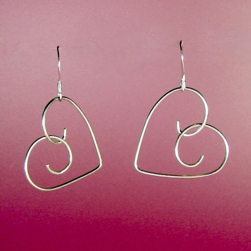 Hand-formed .925 sterling silver hearts of 20 gauge wire suspended ...
