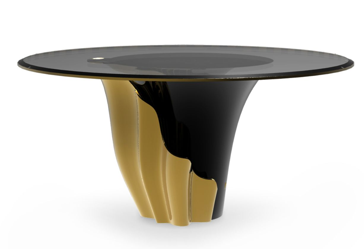 Yasmine Gold Dining table by @koket. The sultry silhouette is fashioned from tailored smoked glass and mounted on a solid wooden base. Classic black lacquer and luxurious gold plated intermix arching back and forth to reveal each color's respective dominance in the design. ➤ Discover the season's newest designs and inspirations. Visit us at  www.moderndiningtables.net #diningtables #homedecorideas #diningroomideas @ModDiningTables