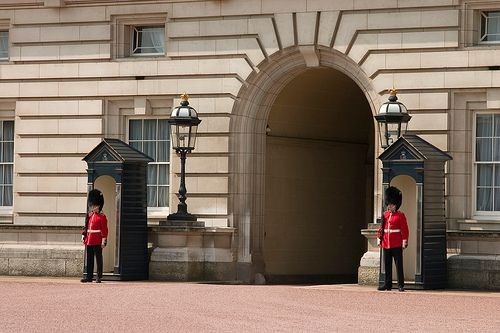 Buckingham Palace Guards guarding the Queen in her London home. Tall, manly, dashing and able to carry off those bearskin busbys with aplomb. The guards that is. Not the Queen.
