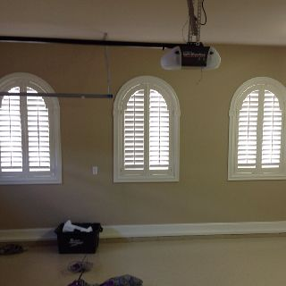 Arch shaped plantation shutters by Affordable Blinds and More of Wilmington, NC