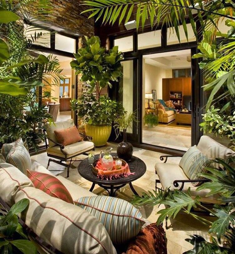 Indoor Courtyard Atrium With A Seamless Flow From Room To Room