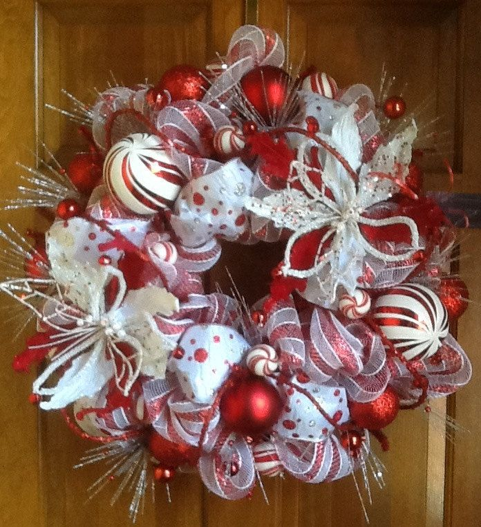 me luvs~S/ Red and White Poinsetta Christmas Wreath. $145.00, via Etsy.