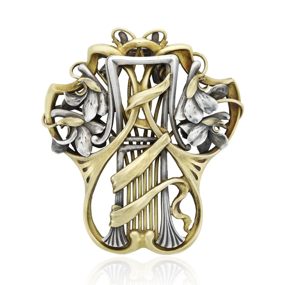A signed André Falize Art Nouveau mixed metal large openwork pin/pendant depicting stylized flowers. French, circa 1900.