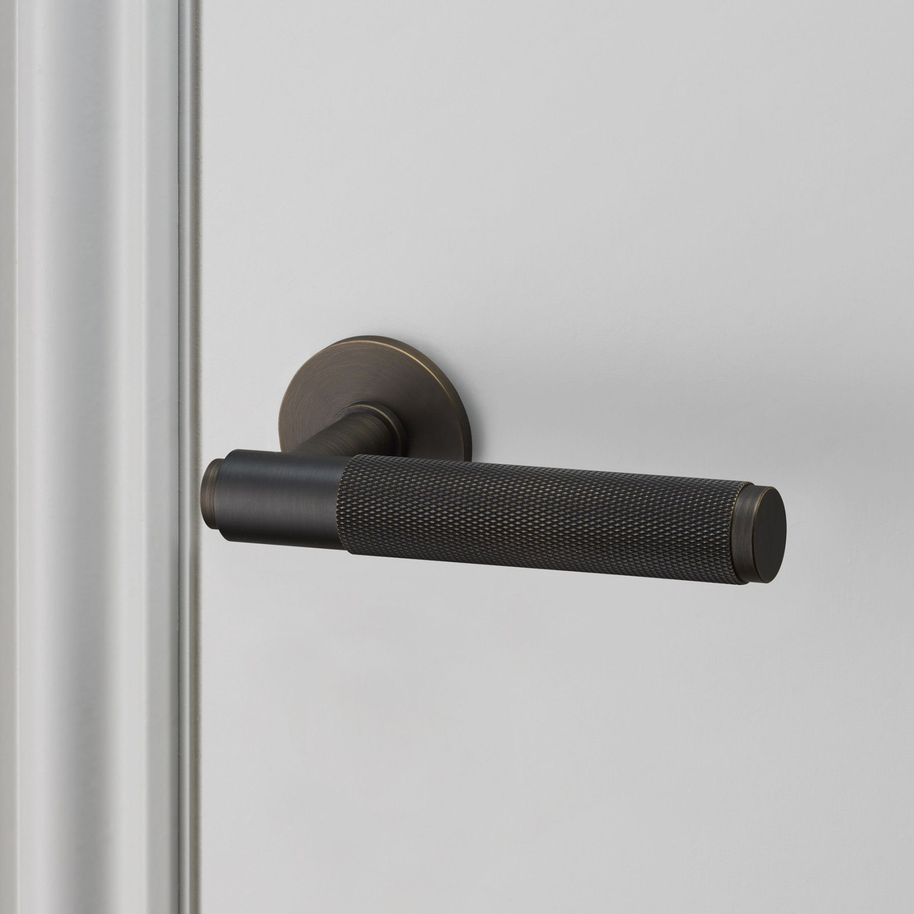 An indoor lever handle made from solid metal, a solid bar with ...