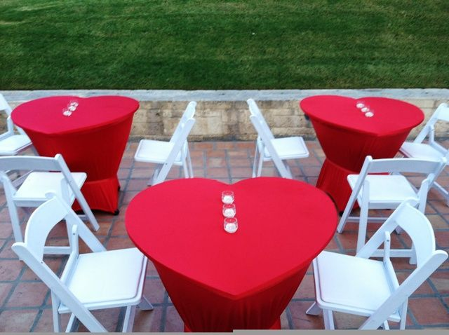 Love is in the air!  Love these tables.  We had them custom made and then covered in heart red spandex.  Love em!  DAVE