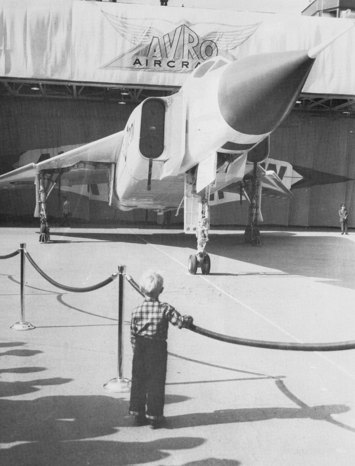 avro arrow rl rollout avro arrow  a little boy watches the canadian built fighter the avro arrow as it is wheeled out of its hangar in 1958 or