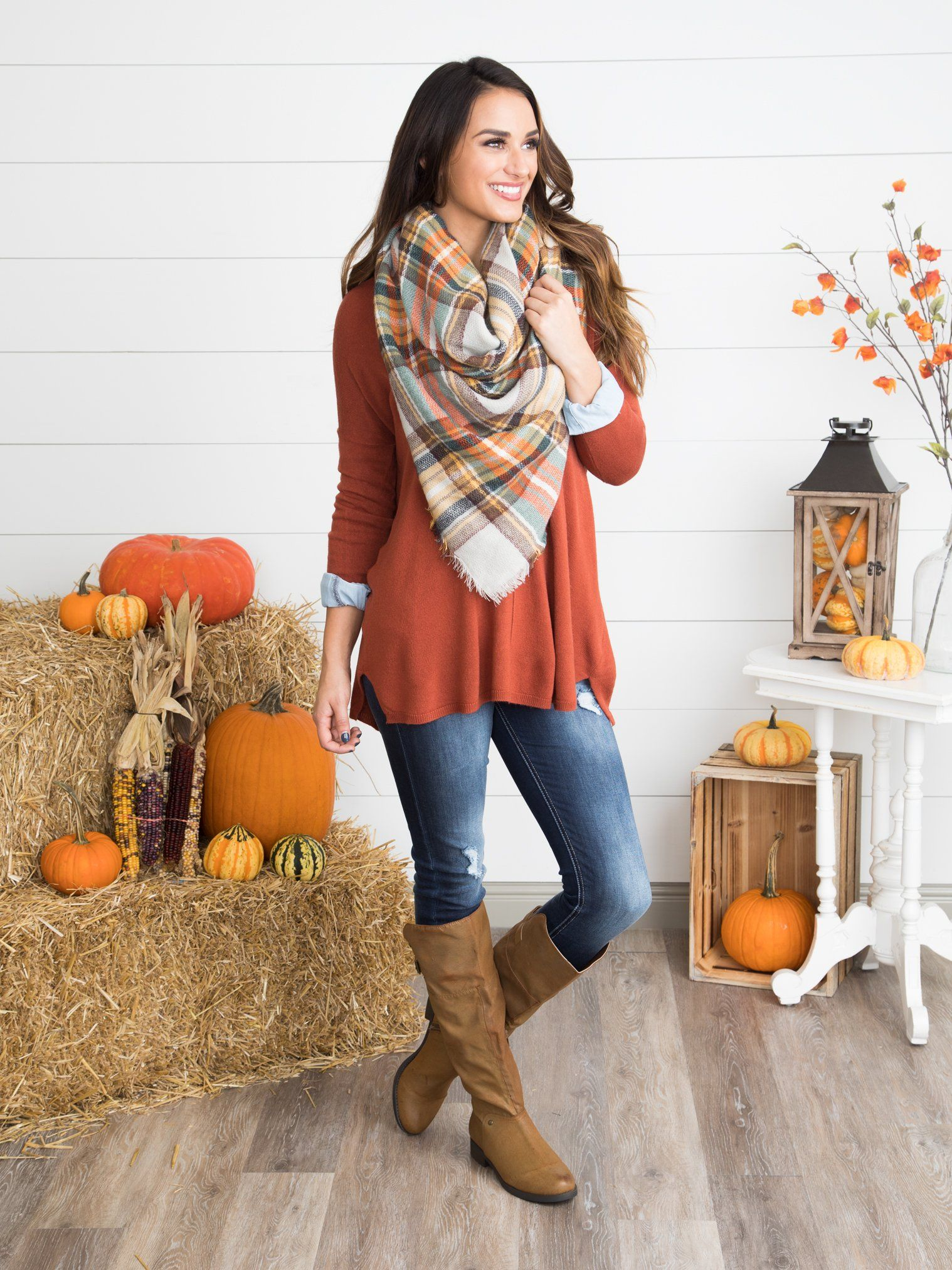 537e55e60573 Cozy, classic and casual combine in this warm and rich rust sweater. With a  v-neckline and slouchy fit, this beauty is a no-brainer go-to piece as the  ...