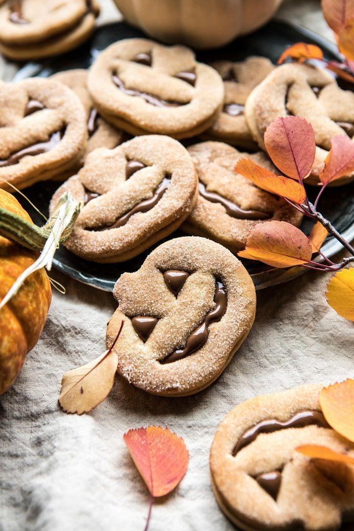 Milk Chocolate Stuffed Jack-O'-Lantern Cookies   halfbakedharvest.com #halloween #thanksgiving #cookies #easyrecipes #chocolate #holidayrecipes #fallrecipes